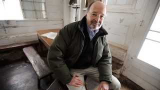 Stanley A. Temple, University of Wisconsin-Madison emeritus professor of forest and wildlife ecology and senior fellow at the Aldo Leopold Foundation, inside the historic Aldo Leopold Shack in Baraboo, Wisconsin. Photo by Jeff Miller/UW-Madison