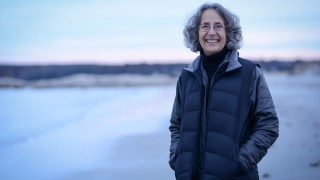 Deborah Cramer, author of The Narrow Edge, at Wingersheek Beach, Gloucester, Massachusetts. Photo by Shawn G Henry.