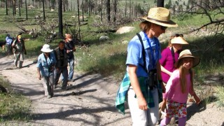 Christina Sherr (foreground, in blue shirt) and her daughter Delaney lead participants on a bird walk during the Mono Basin Bird Chautauqua in June 2015. Photo by Maya Khosla