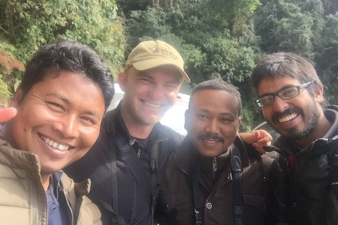 Noah Strycker (wearing cap) celebrates with guides in India on December 29, 2015, after spotting his 6,000th bird species during his global Big Year. Photo by Noah Strycker.