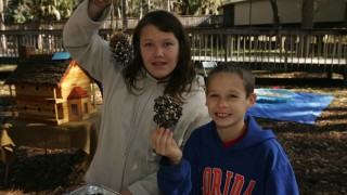 Children showing bird feeders made at a craft fair at St. Marks National Wildlife Refuge visitor center. Photo by Steve Hillebrand (USFWS).