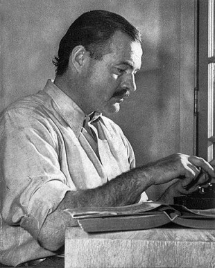 "Ernest Hemingway, posing for a dust jacket photo by Lloyd Arnold for the first edition of ""For Whom the Bell Tolls."""