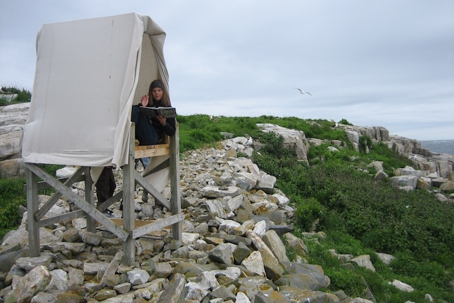 The author records data about Appledore's gulls in her tent-like blind in June 2007. Photo by David Brown