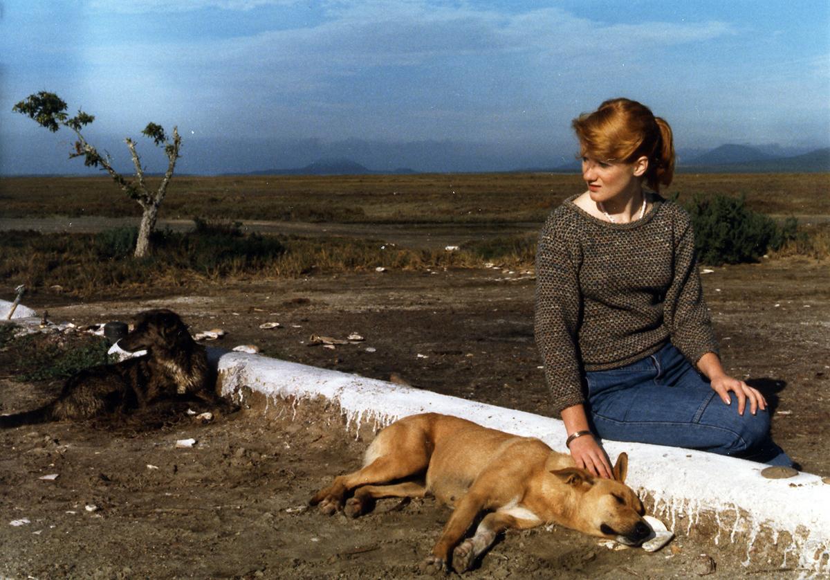 Hollin Stafford petting a dog.